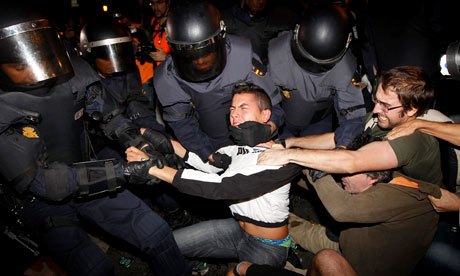 iot police struggle with protesters during demonstrations in Madrid against austerity cutbacks. Photograph: Chema Moya/EPA